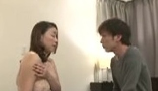 Japanese Mom Cares for Boy before Bed Time