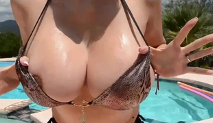 Busty Boobies Wet in Pool