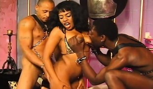 Enticing caramel hooker has two black boys drilling her holes at once