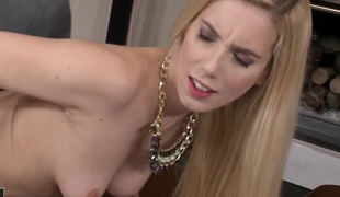 Nesty is a blonde in hot stockings. They do little to cover her massive ass. She's on her knees and is doing it doggy style with her melons moving back and forth.