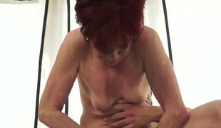 Redhead short haired milf bends over for a young man