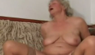Insatiable granny is screwed in sideways position