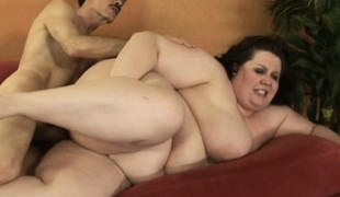 Big tit fatty with a unshaved bush chomps on his prick and is drilled