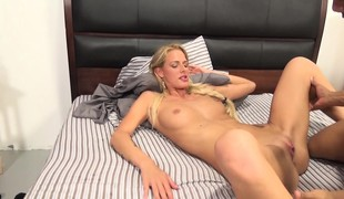 Slender blonde with hot lengthy legs fucks a black stick and cums hard