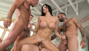 Slutty brunette with big round boobs takes on a gang of cocks at work